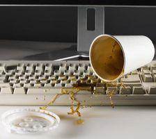 Come riparare una tastiera di computer portatile che Coca versato su di esso