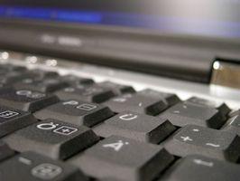 Come pulire la tastiera su un portatile Toshiba Satellite dopo una fuoriuscita di Drink
