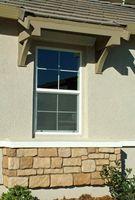Farlo voi stessi finestra sostituzione con Stucco Siding